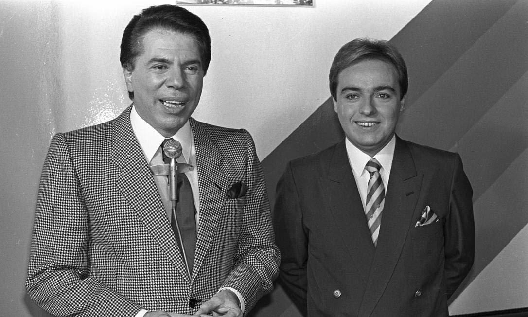 Silvio Santos e Gugu Liberato em registro do 'Programa Silvio Santos', em 1988 Foto: Arquivo O Globo / Agência O Globo